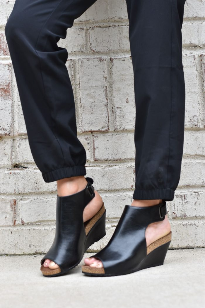 black wedge shoes and black pants