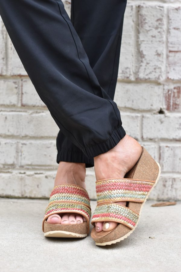 black pants and woven wedges